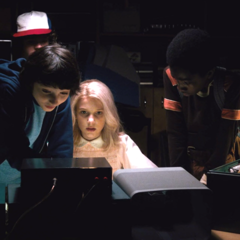 The boys and Eleven using the radio to contact Will.