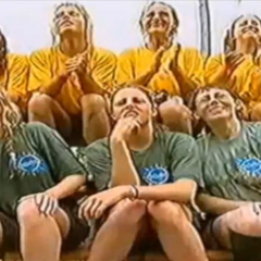 The original North, South teams watching on the sidelines as the East and West teams compete for immunity