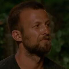 Vytas watching the vote reveal at Tribal Council.
