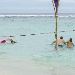 The men prepare to swim out.