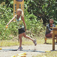 Tina throws a ball in the Immunity Challenge.