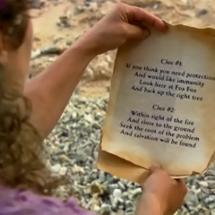 Shambo reads the clue to the Hidden Immunity Idol