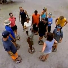 The Castaways standing on the discs.