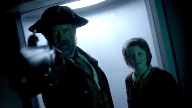 File:Avery and his son subdue Kovarian.jpg