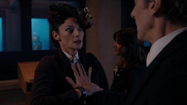 File:The Doctor feels Missy's hearts.jpg