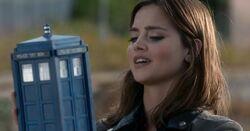 Clara holds the TARDIS