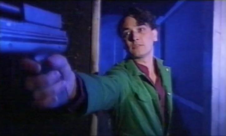 Nikos holding gun