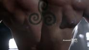 Triple spiral tattoo