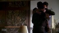 Charley hugs john
