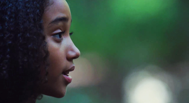 File:Rue talking to Katniss.png
