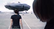 Katniss walking towards hovercraft