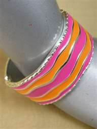 File:Marigold Summer's District Token (Orange, Pink & Silver Bangle).jpg