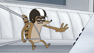 S4E21.233 Rigby Reaching for the Red Button