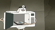 S8E25.051 Microwave Pulling Out a TV Dinner