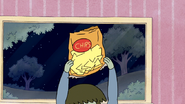 S4E07.029 Muscle Man Holding a Bag of Chips