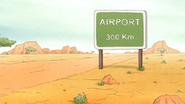 S6E13.067 Airport 300 Km Sign