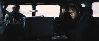 The research crew inside Snowcat, The Thing (2011)