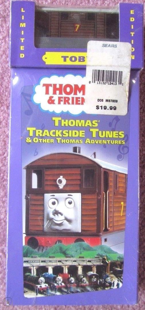 File:Thomas'TracksideTunesVHSwithWoodenRailwayToby.jpg