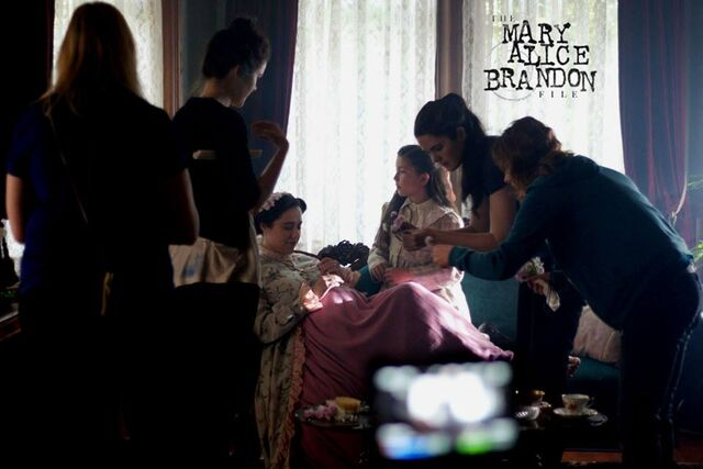 File:Directors Kailey and Samantha Spear prepping flower scene with Barbara Beall (Lillian Brandon), Emma Tremblay (Young Mary Alice Brandon) and Props Master Dana Dolezsar.jpg