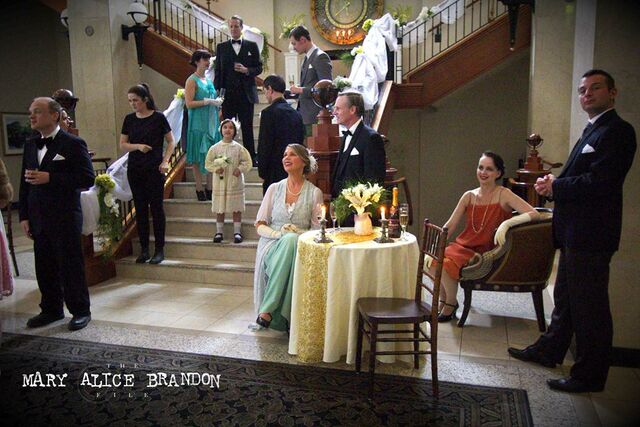 File:Wedding guests between takes (can you spot the person not supposed to be in the scene).jpg