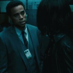 Detective Sebastian speaks with Selene.