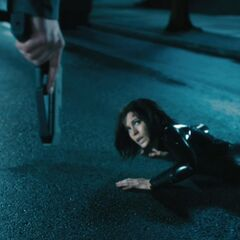 A security guard prepares to shoot Selene.