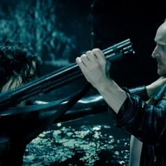 Selene and Marcus fight for control of a shotgun.