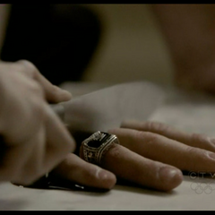 John's ring cut off when Katherine was acting as Elena.