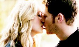 Klaus and Caroline kiss,,