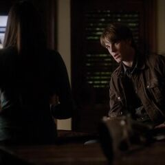 Same view, different angle. Kol is sitting on the back of the leather couch