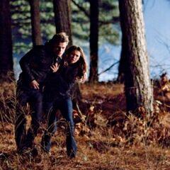 Elena helping Stefan.