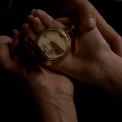 Elena holding the compass, it's pointed at Stefan.