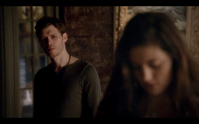 File:4x16-Hayley looking through Klaus' art.png