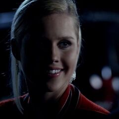 Rebekah wearing Matt's letterman jacket.