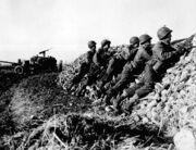 Infantry anti-tank crew fires on Nazis