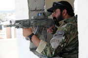 Afghan border police aiming a weapon