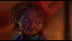 Chucky hold a gun