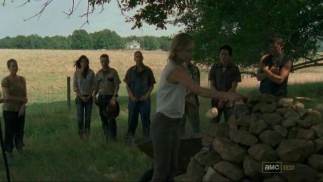 File:Beth placing rocks on Otis' funeral.JPG