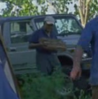 File:Joe H carrying wood (Vatos).png