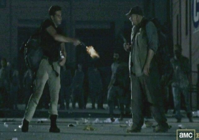 File:The-walking-dead-mysteries-why-did-shane-jon-bernthal-shoot-otis-in-the-leg-pulling-a-515564.jpg