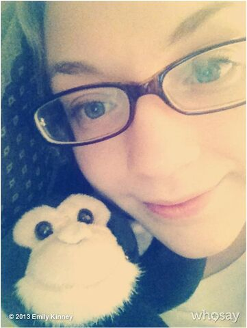 File:Emily in cute glasses with monkey doll.JPG