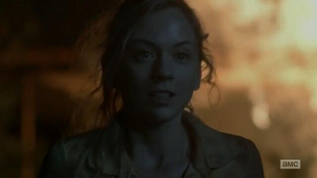 File:Beth walking away from the fire in episode still.JPG