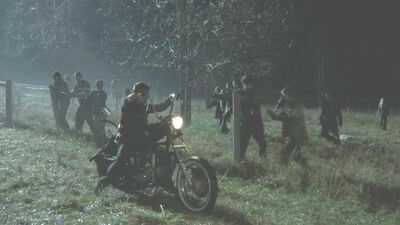 Daryl driveing away from walkers