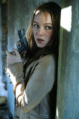 File:April With A Gun.jpg