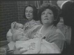 Shaineh Berkowitz with her child
