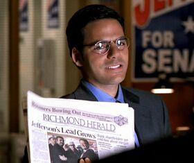 Jock Busfield holding newspaper