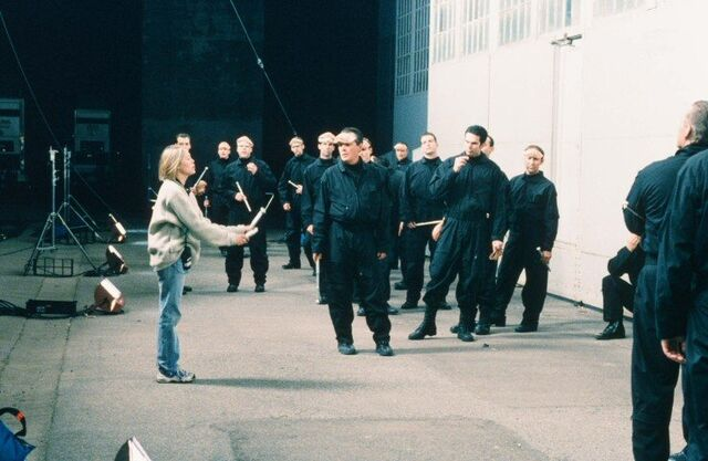 File:Stephanie Herrera directs faceless alien performers.jpg