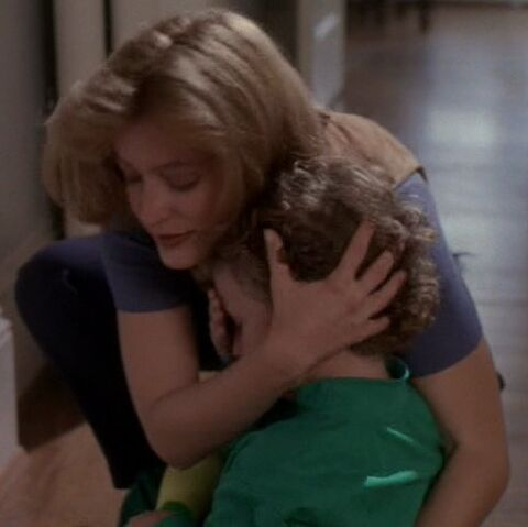 File:Trent held by Scully.jpg