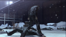 Saejima stomps Kugihara's wrist harder