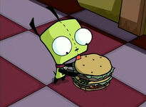 GIR licks a hamburger